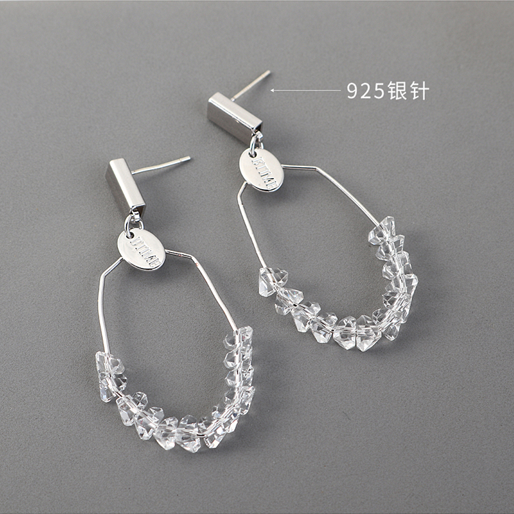 Fashion gold plated crystal glass hollow S925 silver pin earrings wholesale NHSE203146